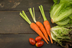 The fresh lettuce , carrot and tomato Royalty Free Stock Image