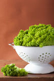 Fresh lettuce leaves in colander Royalty Free Stock Image