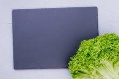 Fresh lettuce and slate tray. stock photo
