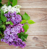Fresh lilac flowers on wooden. Background border Stock Photos