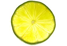 Fresh lime. Fresh backlit slice of lime isolated on white Royalty Free Stock Photography