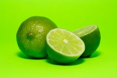 Fresh lime. On green background stock photography