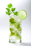 Fresh lime cocktail with ice. Isolated background Royalty Free Stock Photo