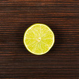 Fresh lime on dark wooden table. Top view Royalty Free Stock Photography