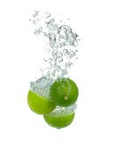 Fresh lime. Falling into water, isolated on white background Stock Photo
