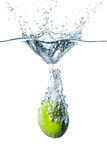 Fresh lime falling into water. Isolated on white background Royalty Free Stock Photos