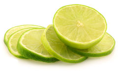 Fresh lime fruit and some thin slices. On a white background Royalty Free Stock Photography
