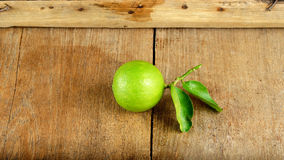 Fresh lime fruit on the wooden background Stock Image