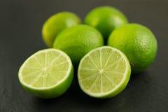 Fresh lime fruits on dark background. Healthy lime fruits on dark background Stock Photography