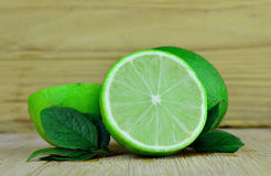 Fresh Lime fruits. Lime fruits on a desk background Royalty Free Stock Photo