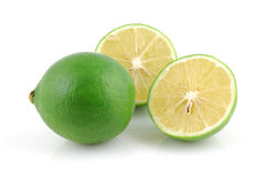 Fresh lime and halved Royalty Free Stock Image