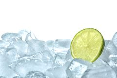 Fresh lime on ice cubes. Against white background stock photo