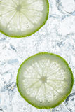 Fresh lime and ice cubes. In soda Stock Photos