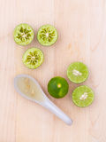 Fresh Lime juice in spoon and lime slice Royalty Free Stock Images