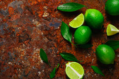 Fresh lime with leaves on rusty metal background Stock Images
