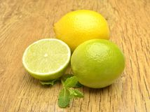 Fresh lime and lemon. On wooden background Royalty Free Stock Image