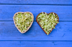 Fresh lime linden tree blossoms in heart shaped wicker baskets Stock Photos