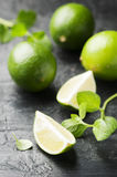 Fresh lime and mint on the black table. Selective focus Royalty Free Stock Image