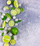 Fresh lime, mint and ice. Ingredients for Mojito. Fresh lime, mint and ice on grey background. Ingredients for Mojito or Cocktail. Top view stock image