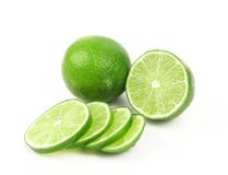 Fresh lime and slices. Stock Photos