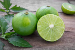 Fresh lime with slices on wooden table Royalty Free Stock Photography