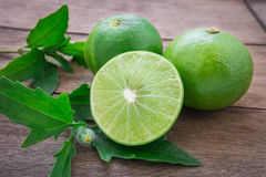 Fresh lime with slices on wooden table Royalty Free Stock Photo