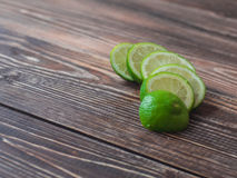 Fresh Lime slices on wooden table, close up.  Royalty Free Stock Image