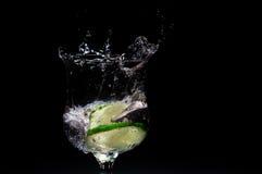 Free Fresh Lime Splashing Into Glass Of Liquid Stock Photos - 12654743