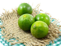 Fresh lime and tablecloth. On white background Royalty Free Stock Photo