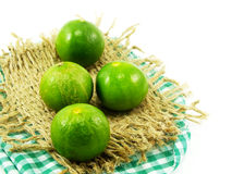 Fresh lime and tablecloth. On white background Stock Photography
