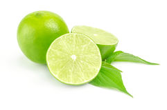Fresh lime with two half Isolated on white Royalty Free Stock Photos