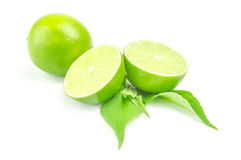 Fresh lime with two half and leaves Isolated on white background Stock Photo