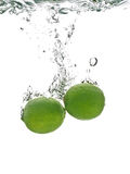 Fresh lime in water. On a white background with air bubbles Stock Photography
