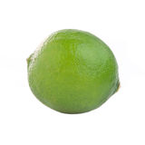 Fresh lime on white background. Fresh green lime isolated on white background Royalty Free Stock Photography