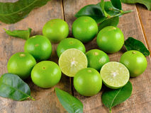 Fresh lime  on wooden  background. Fresh lime  on a wooden  background Stock Image