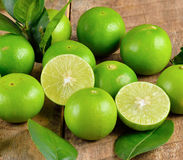 Fresh lime  on wooden  background. Fresh lime  on a  wooden  background Royalty Free Stock Photography