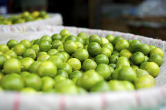 Fresh limes. At the fruits and vegetable market in Bangkok, Thailand Royalty Free Stock Photography