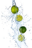 Fresh limes. With water splash, isolated on white background Royalty Free Stock Image