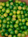 Fresh limes. Fresh green limes on asian market Stock Photos