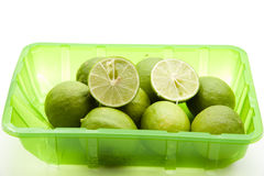 Fresh limes halves in the packaging Stock Photos