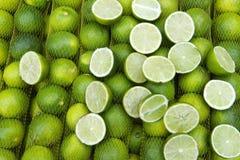 Fresh Limes Hang in Sacks at Farmers Market Rio de Janeiro Stock Images