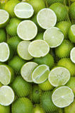 Fresh Limes Hanging in Sacks at Farmers Market Rio de Janeiro Royalty Free Stock Photos