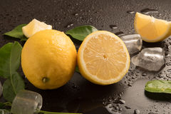 Fresh Limes with leaves and ice cubes Stock Photo