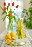 Fresh limes and lemonade Stock Images