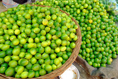 Fresh green and yellow limes at the market Stock Images