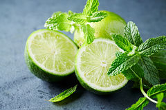 Fresh Limes and Mint Leaves Stock Photo
