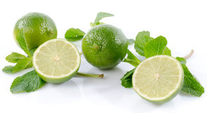 Fresh limes with mint leaves Royalty Free Stock Photography