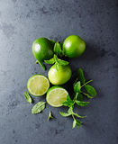 Fresh Limes and Mint Leaves Stock Image