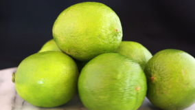 Fresh limes rotating on a board stock video