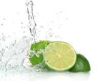 Fresh limes with Splashing water Stock Photos